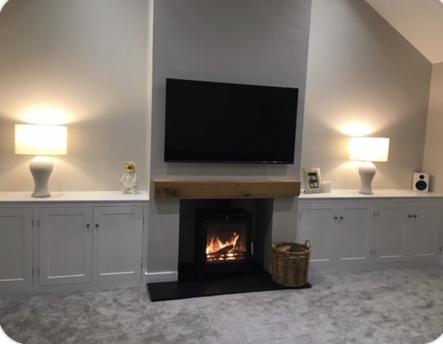 chunky oak mantel in living room with inbuilt storage alcoves