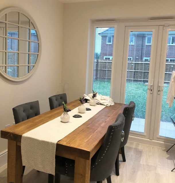 solid wood dining table in dining room
