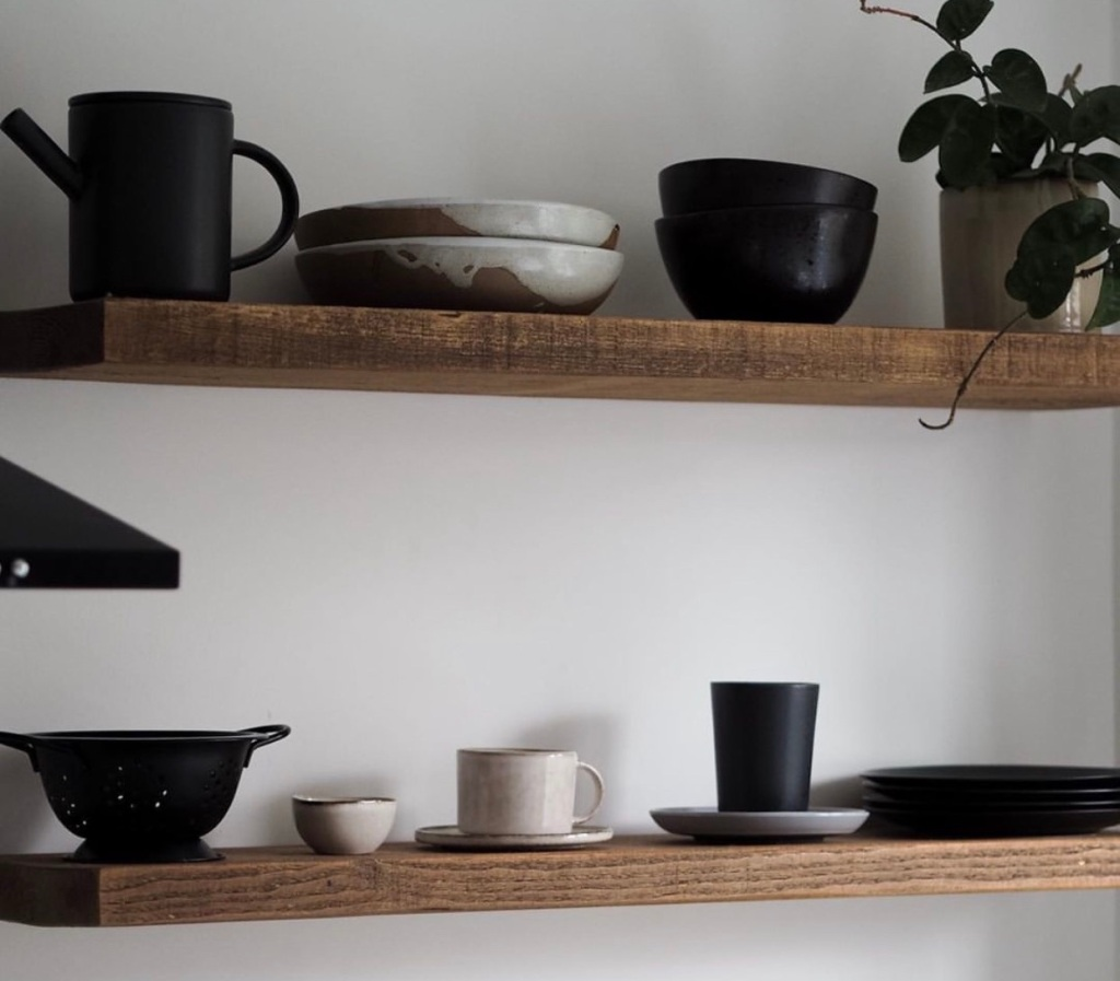 Monochrome kitchen floating shelves on a rustic floating shelf with gothic wax finish