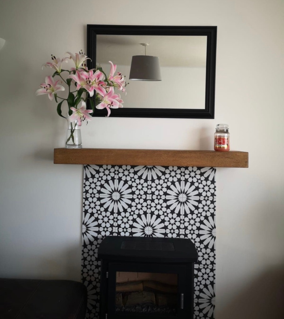 Oak Mantel on a Tiled Feature Fireplace wall