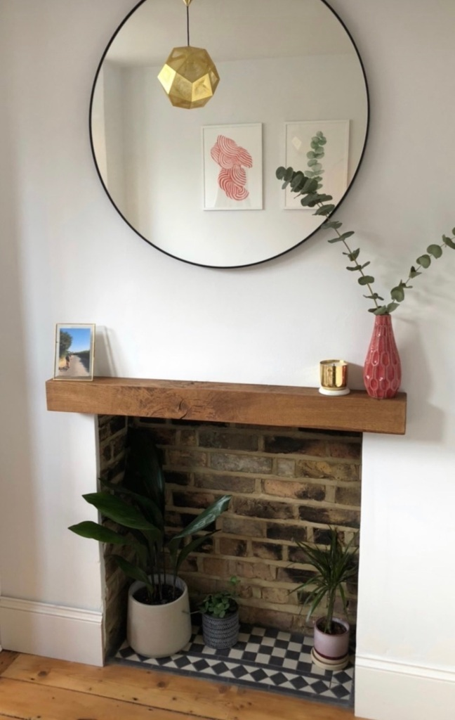 Oak Mantel on white fireplace wall with tiled hearth