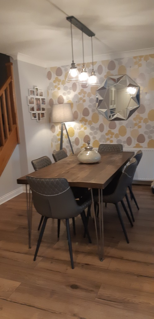 solid wood dining table with raw steel hairpin legs in 1960s inspired dining room