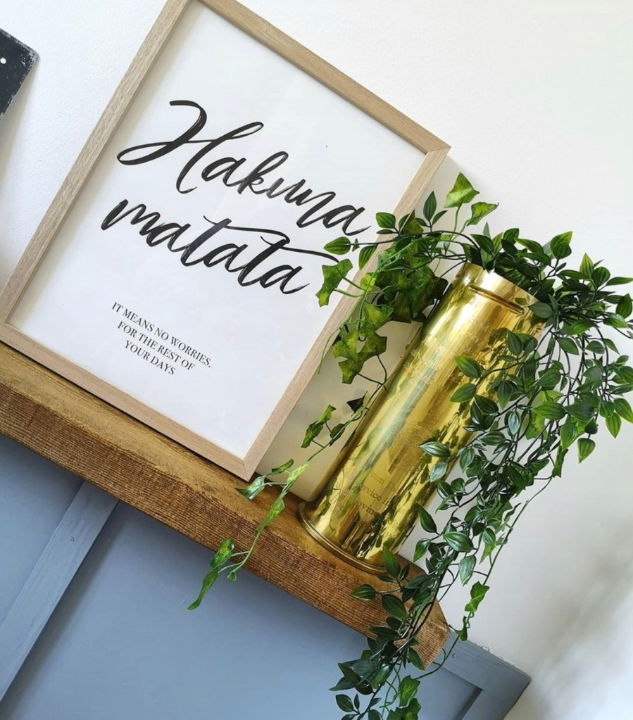 small rustic shelf with houseplant
