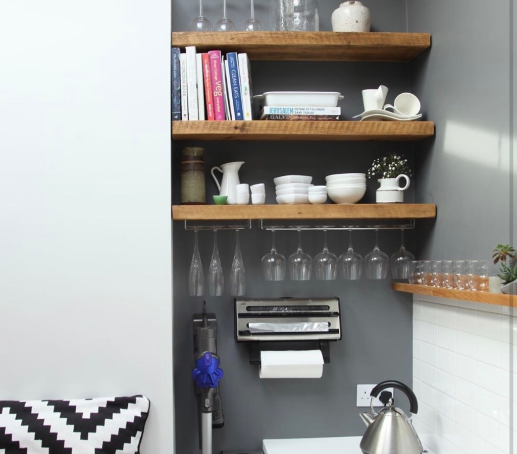 set of three small rustic floating shelves in an alcove in a small kitchen