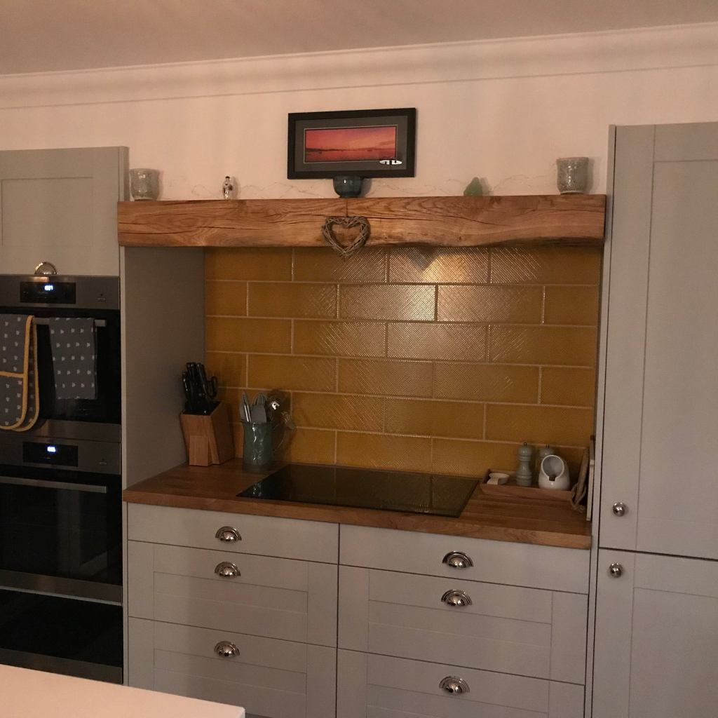 oak beam over hob top in shaker style kitchen
