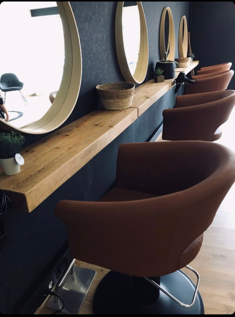 rustic solid wood floating shelves in hairdressers in france
