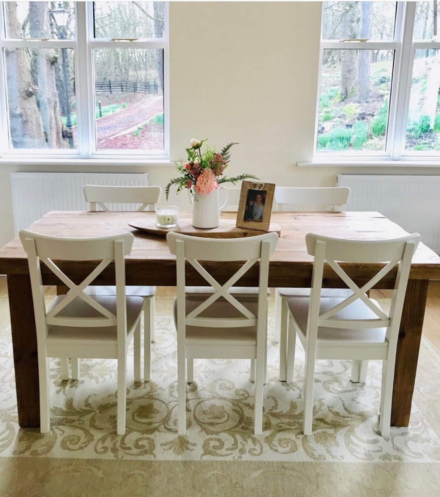 rustic solid wood dining table with white wooden chairs