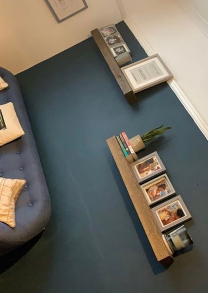 solid oak floating shelves on blue wall in living room