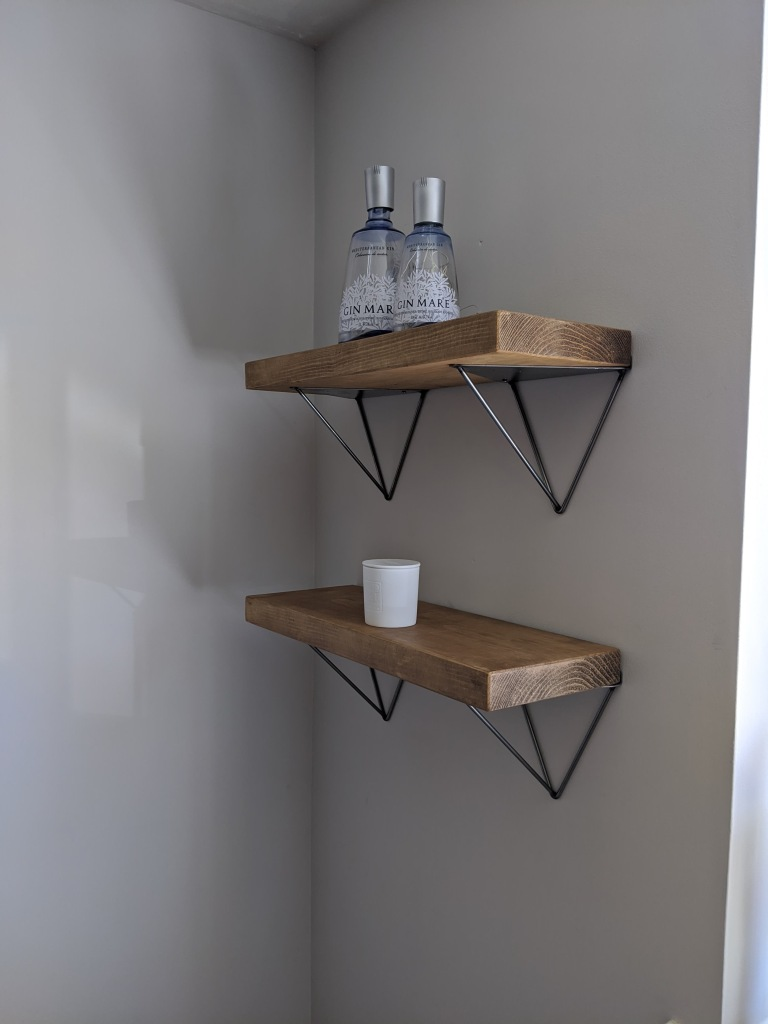 bracket shelves with industrial design in corner of home