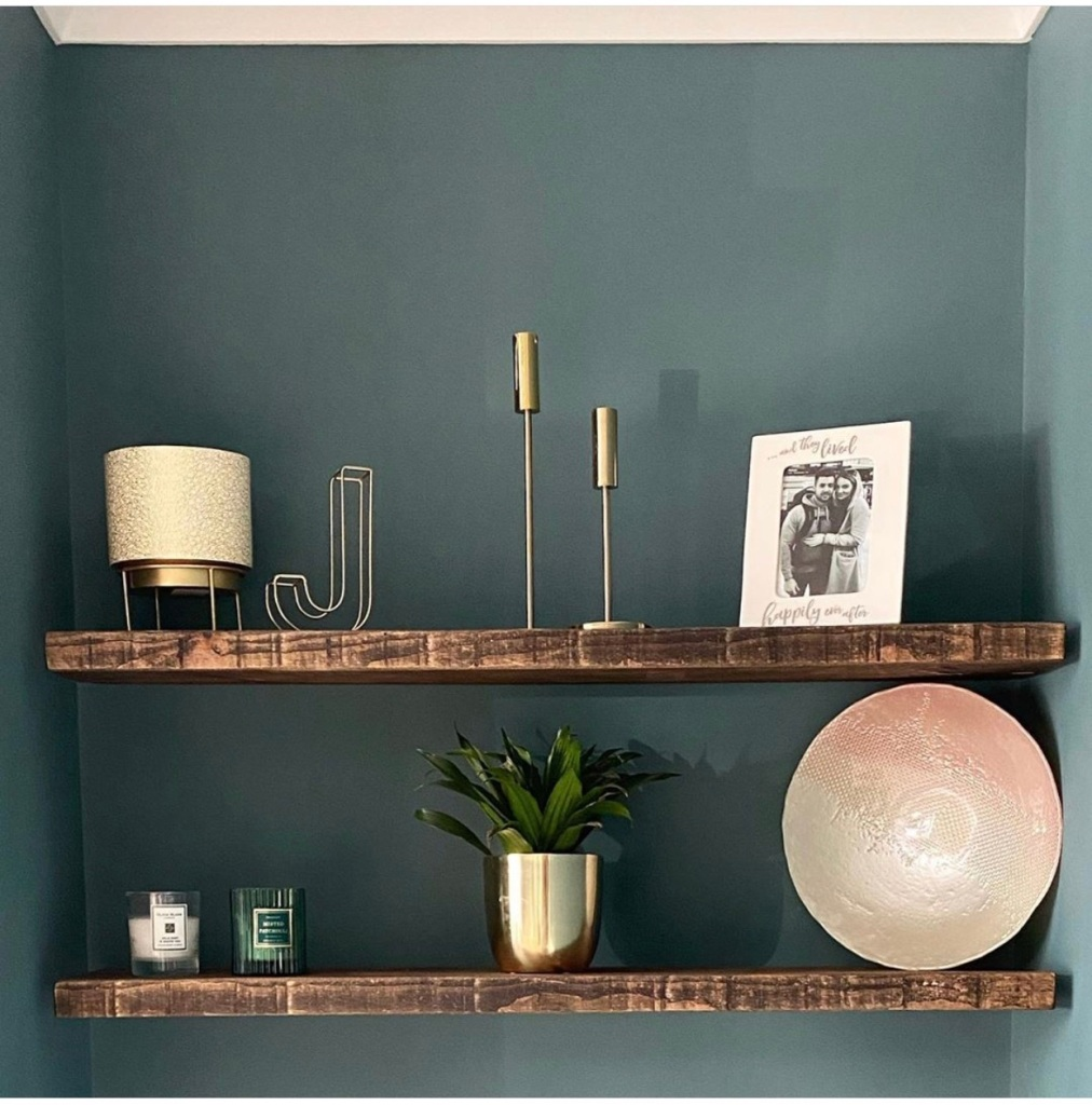 Rustic floating shelves on a green wall in an alcove, alcove floating shelves