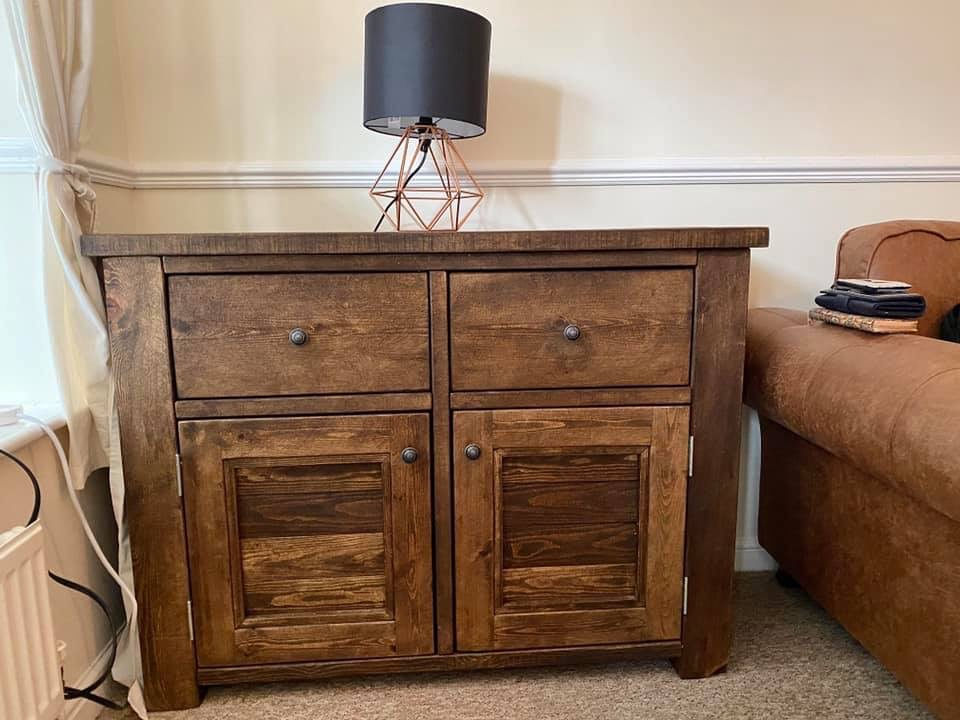 solid wood sideboard with two drawers and two cupboard doors in living room