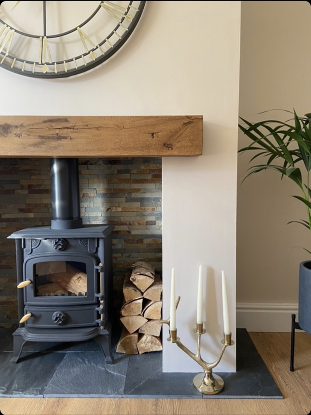 mantel over woodburner on cream wall