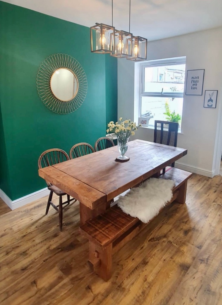 derwent dining table and bench in dining room with wooden floors and bright green wall