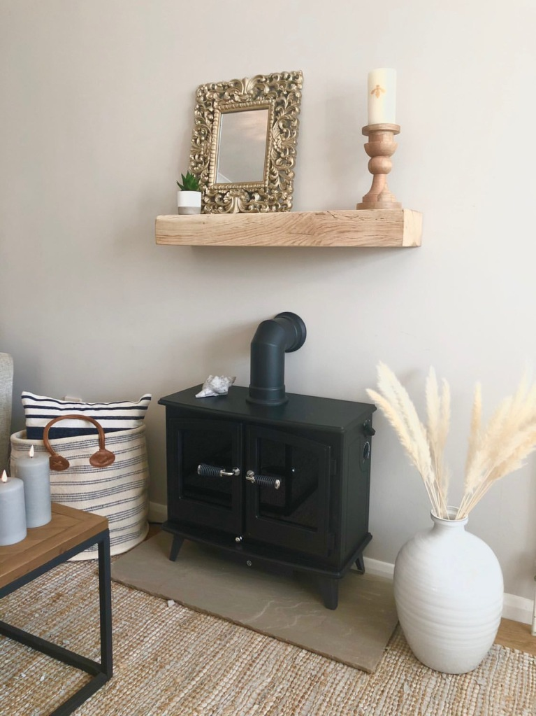 Natural Oak 4x4 Oak Mantel on fireplace above a woodburner in a nautical themed living room.