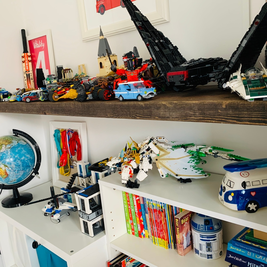 boys bedroom with rustic floating shelf and lego