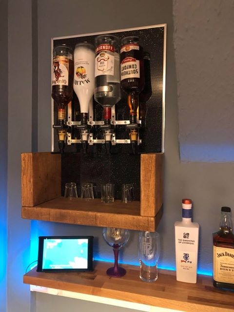 home bar with rustic floating shelf