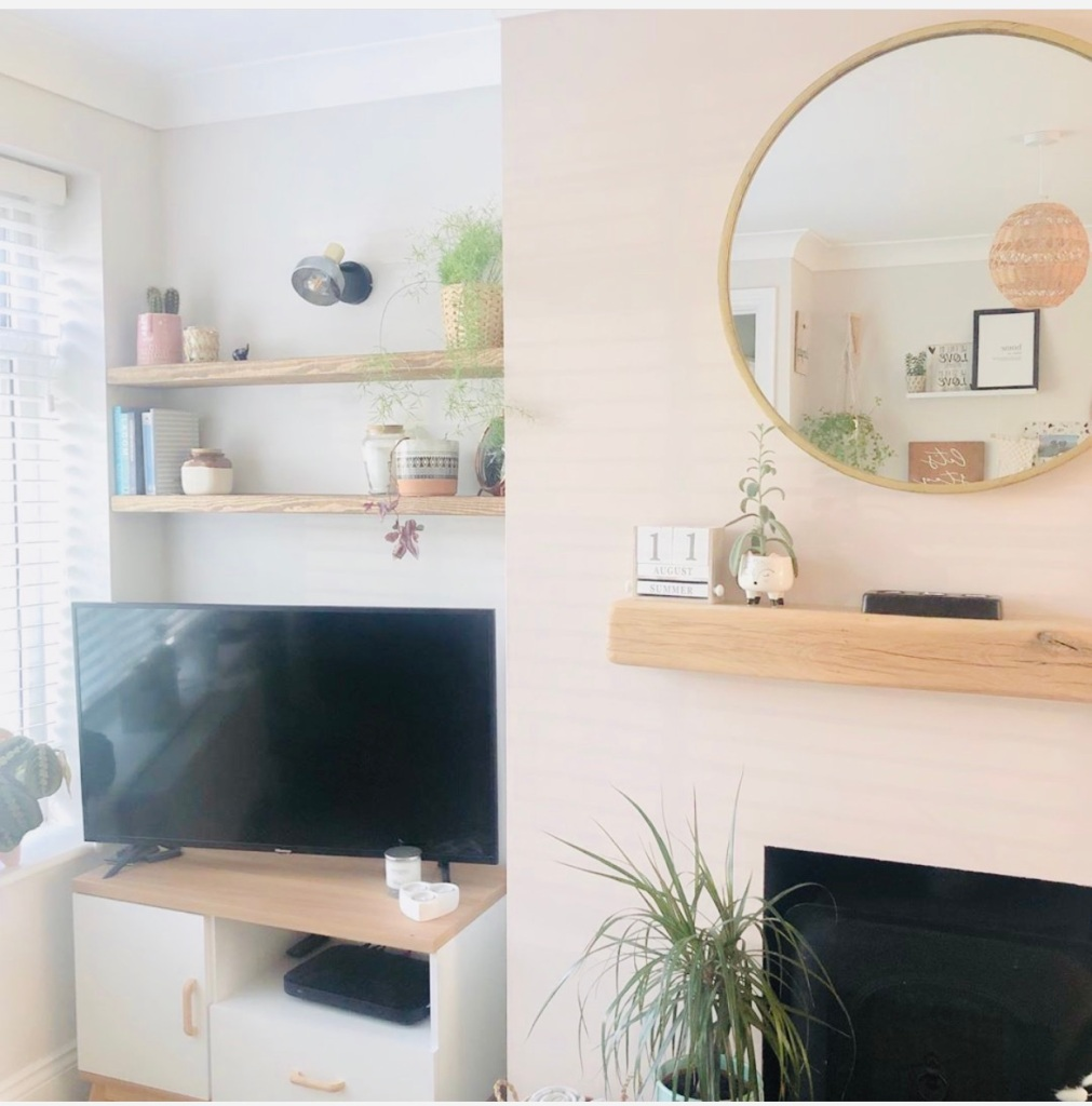 floating shelves in alcove in small living room