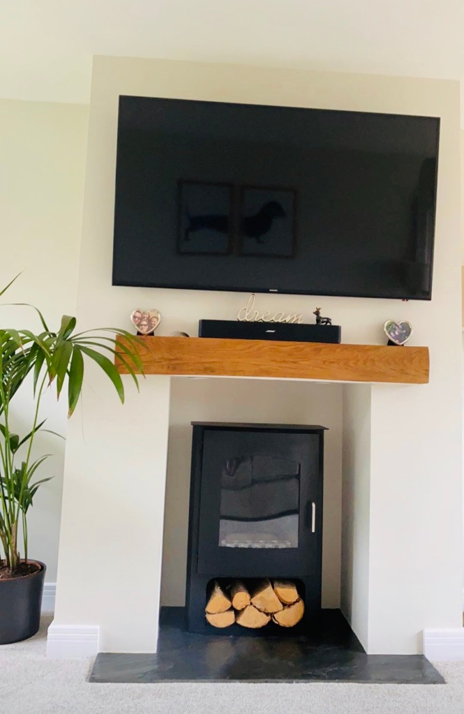 Oak Mantel on fireplace wall with TV above