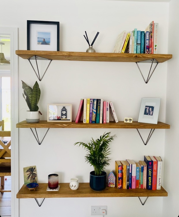 industrial style shelves with hairpin brackets in corner of home