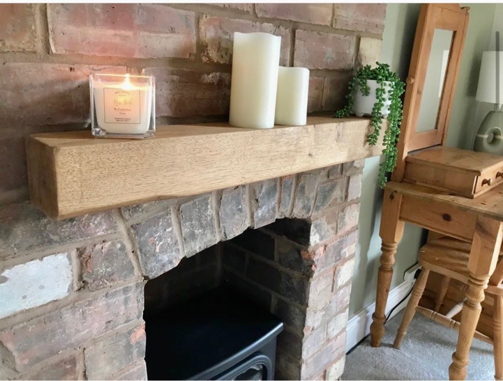 Solid Oak Mantel on Exposed Brickwork Fireplace