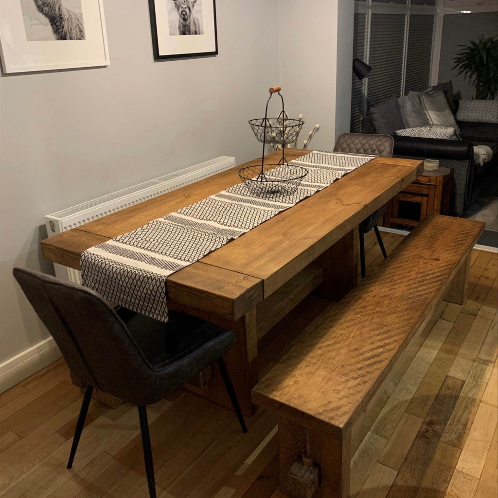 solid wood dining table and benches with silver runner in grey dining room