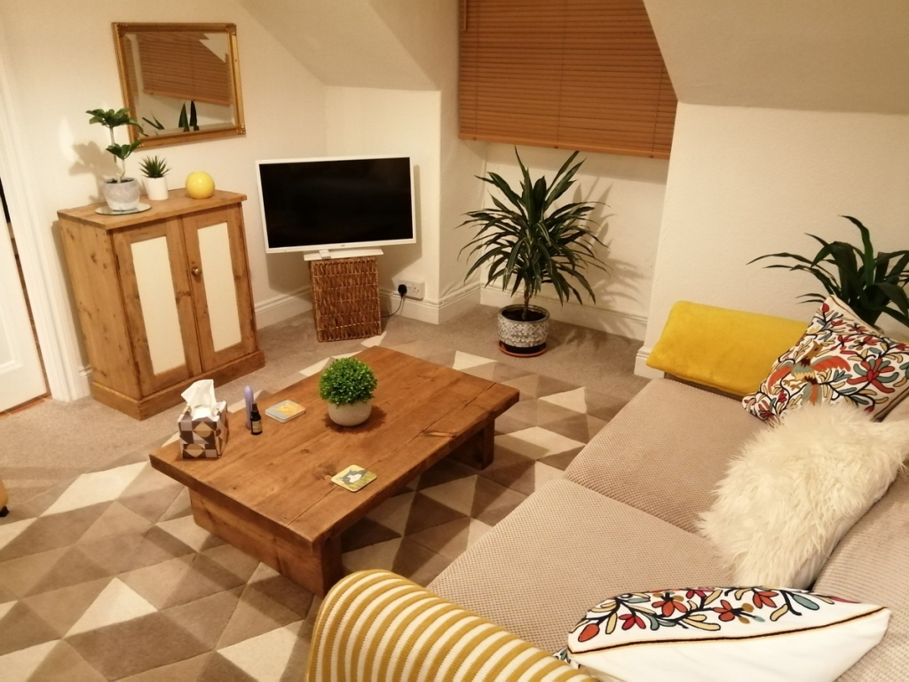 solid wood coffee table in small attic living room