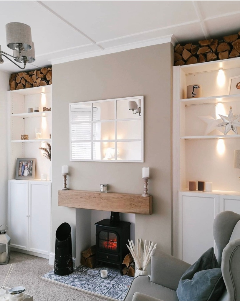 neutral living space with oak mantel above wood burner