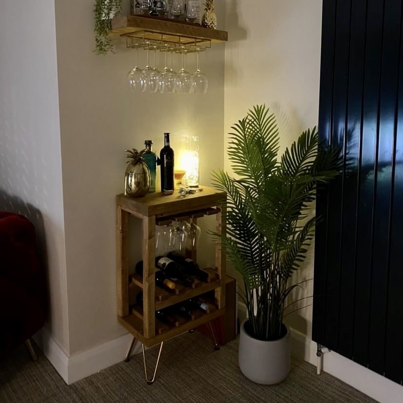 hairpin leg drinks cabinet with brass legs. In corner of room maximising space to create a home bar area